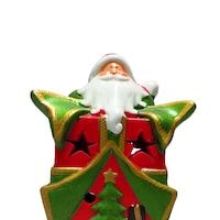 Декоративна фигура на дядо коледа върху подарък